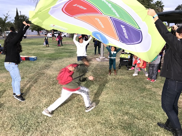 "Kids playing ""My Plate"" parachute games with UC Cal Fresh staff"