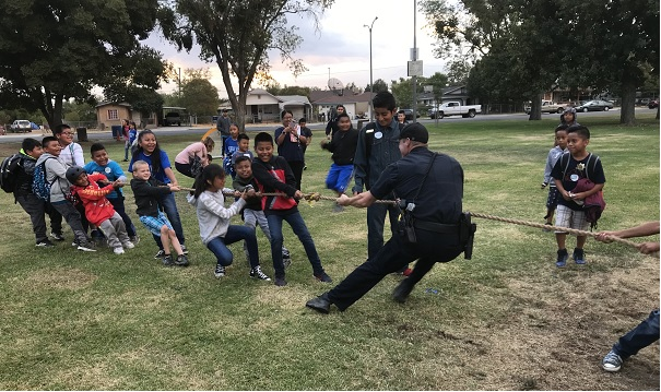 Madera PD Officer handles defeat well after a short-lived game of tug of war