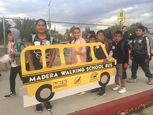 Students pose with the Madera Walking School Bus before class starts
