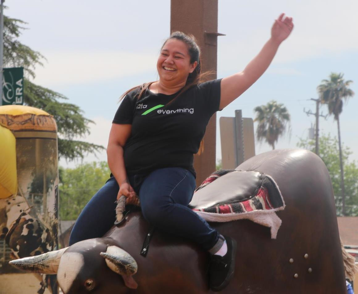 One fearless festival goer braves the mechanical bull